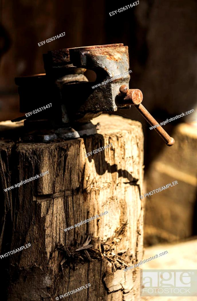 Stock Photo: Metalworking hand tool on a tree stump.