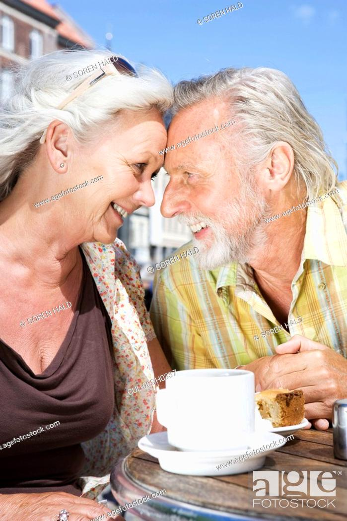 Stock Photo: Couple smiling at each other.