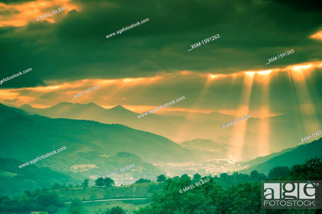 Stock Photo: Clouds and sunbeams  Baztan valley, Navarre, Spain.