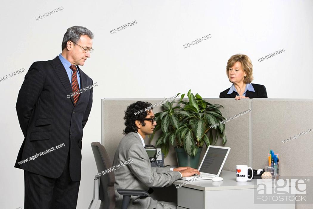 Stock Photo: Businessman watching over work.
