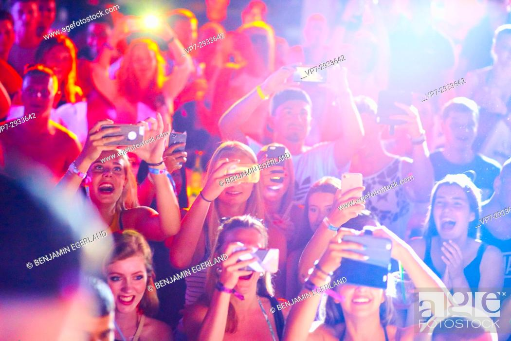 Stock Photo: Excited people with smartphones during Summer Party at music festival Starbeach in Hersonissos, Crete, Greece, on 09. July 2017.
