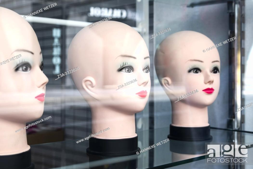 Stock Photo: Three mannequin heads without wigs.
