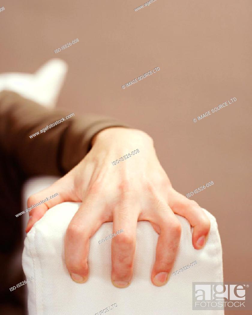Stock Photo: A male hand grabbing the sofa arm.