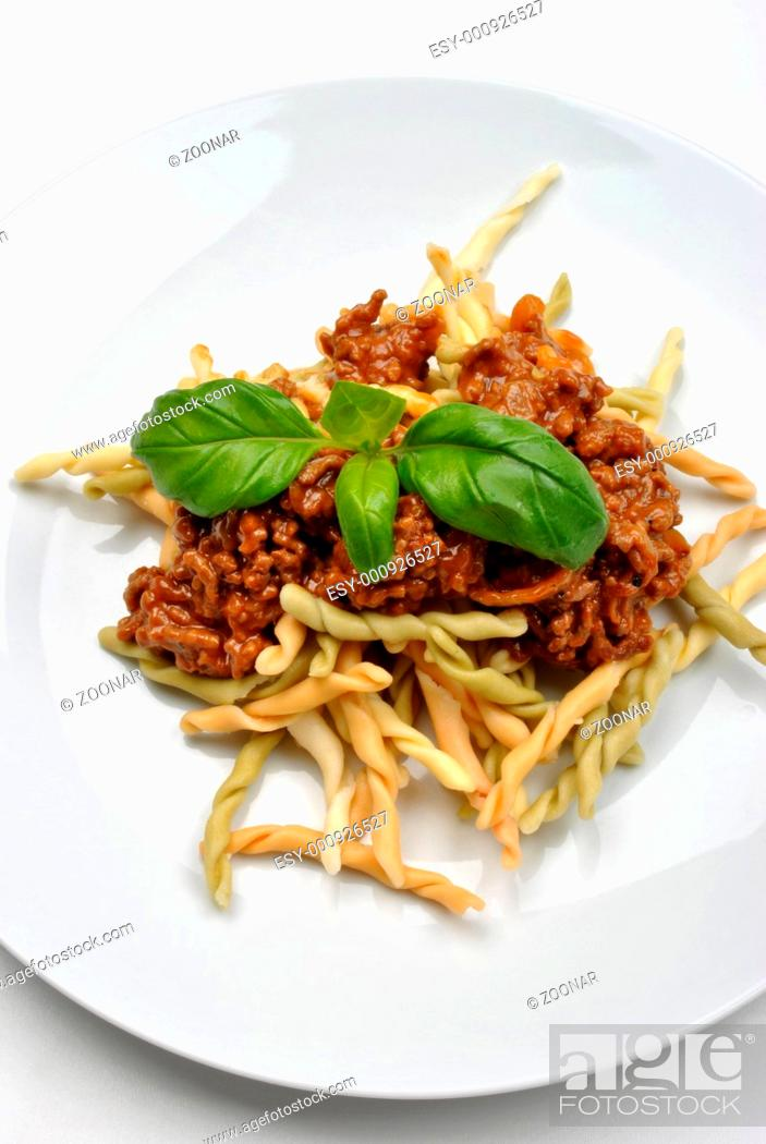 Stock Photo: home made pasta with mince sauce and basil.