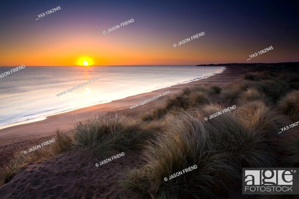 Stock Photo: England, Northumberland, Blyth Beach  Blyth Beach and sand dunes at sunrise, looking south towards Seaton Sluice.