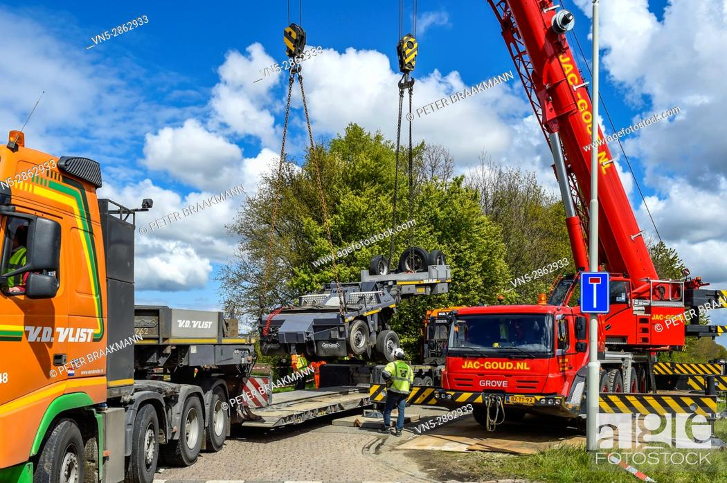 Stock Photo: Wouw - Nederland - An intercity train was bumped on a truck at a railway crossing at the Plantagebaan in Wouw .