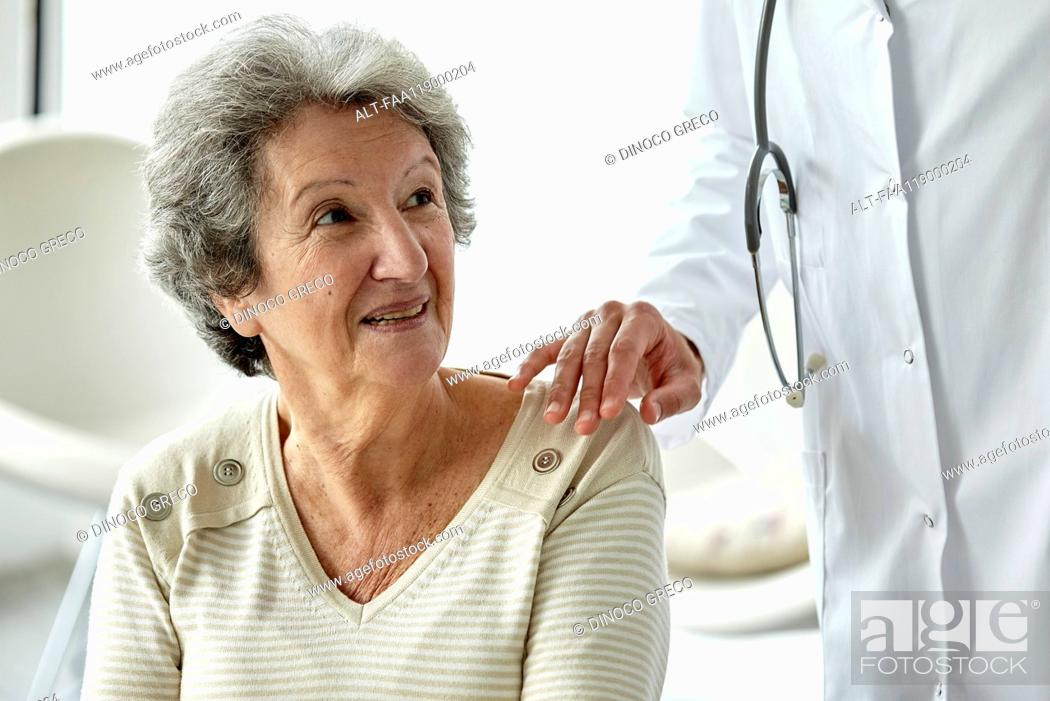 Stock Photo: Doctor consoling senior woman.
