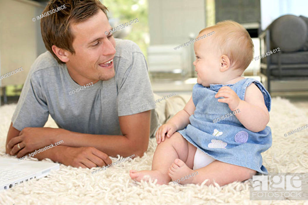 Stock Photo: Portrait of a father with baby daughter.