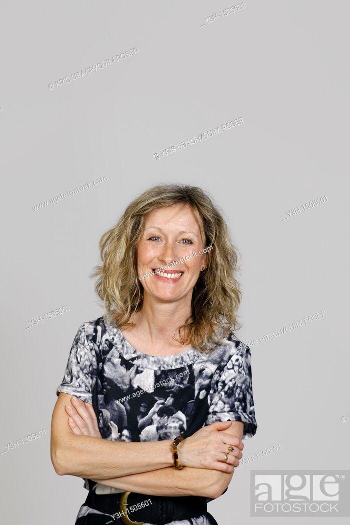 Stock Photo: Studio shot of woman, smiling.