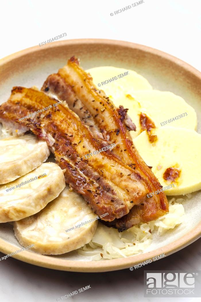 Stock Photo: pork meat with two types of dumplings and cabbage.