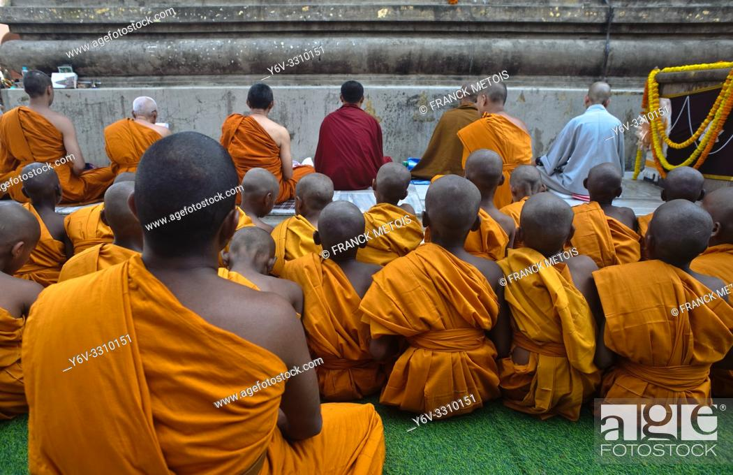Stock Photo: Buddhist boys and monk at the Mahabodhi temple ( Bodhgaya, India). The Mahabodhi temple is considered as the place where the Buddha has attained enlightenment.