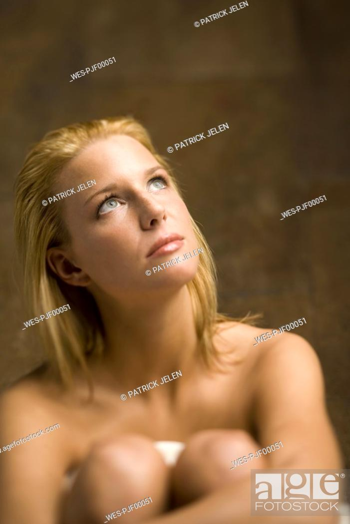 Stock Photo: Topless woman looking upwards.