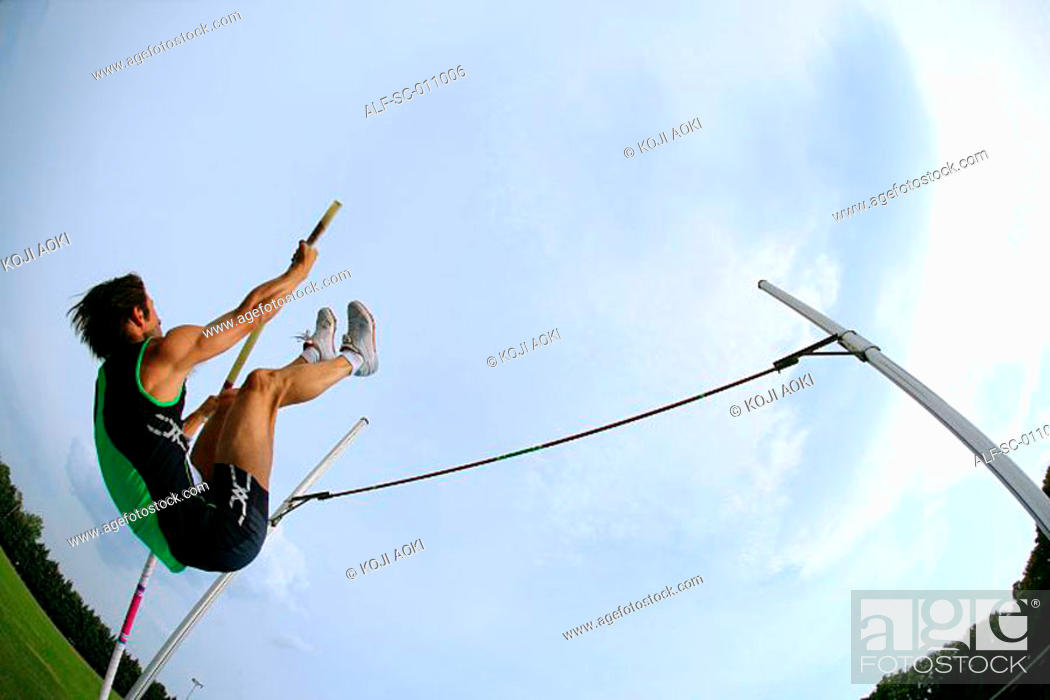Stock Photo: Man Pole Vaulting.