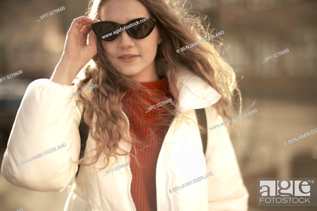 Stock Photo: young cool woman, hand touching sunglasses, in city Cottbus, Brandenburg, Germany.