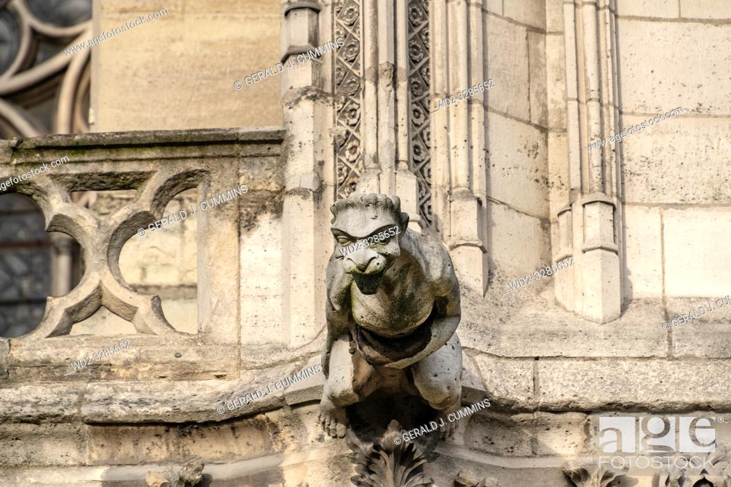Stock Photo: The famous gargoyles of Notre Dame de Paris, a gothic architectural feature used to divert rain water from the roof and convey it away from the buildingâ.