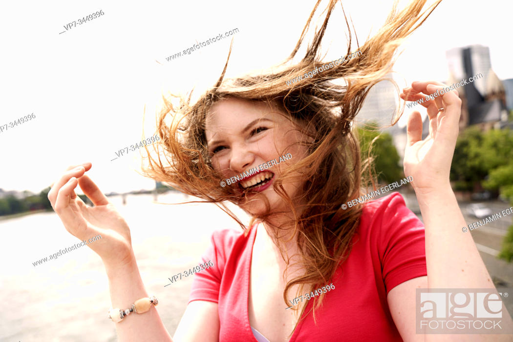 Stock Photo: Portrait of happy young woman. Frankfurt am Main. Germany.