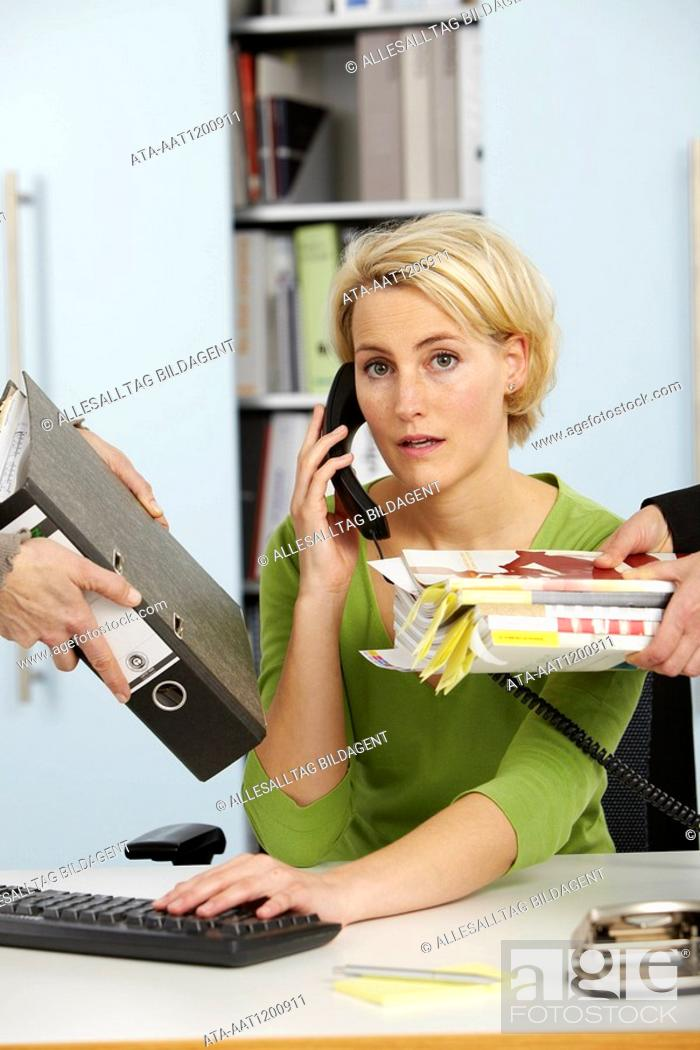 Stock Photo: Woman getting work from all sides.