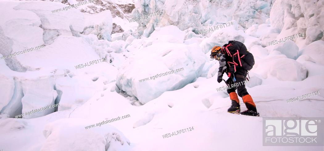 Stock Photo: Nepal, Solo Khumbu, Mountaineer at Everest Icefall.