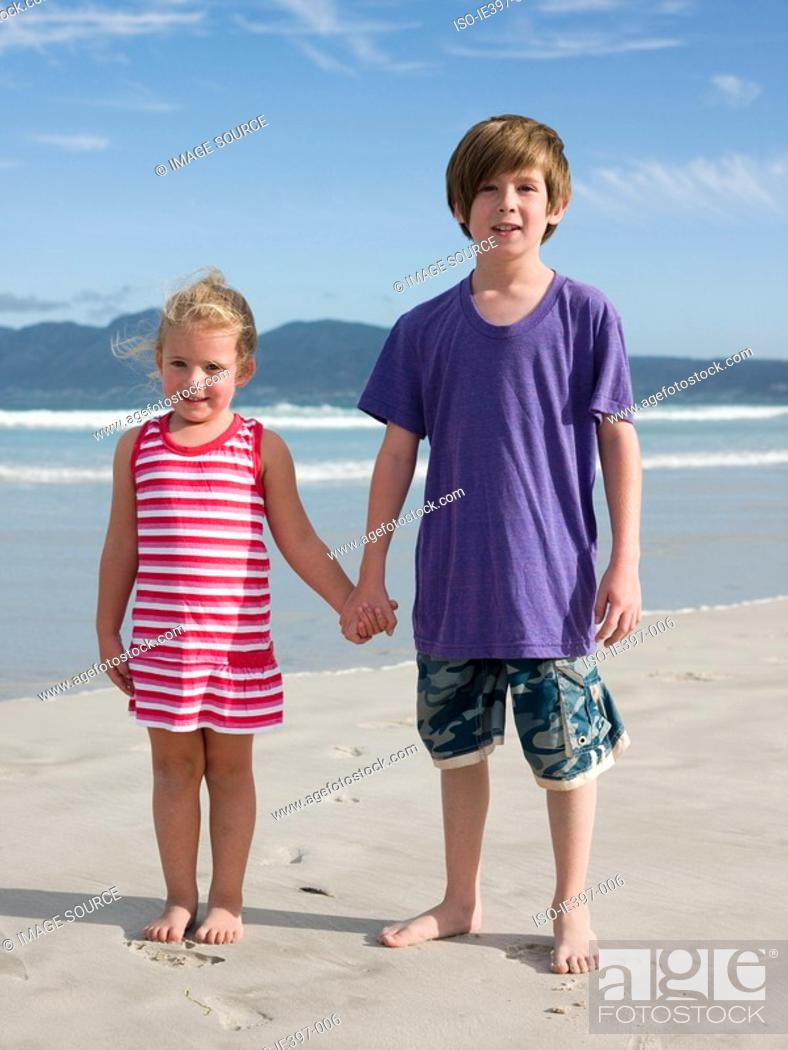 Stock Photo: Brother and sister at the beach.
