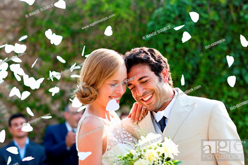 Stock Photo: Newlyweds embracing at marriage ceremony.