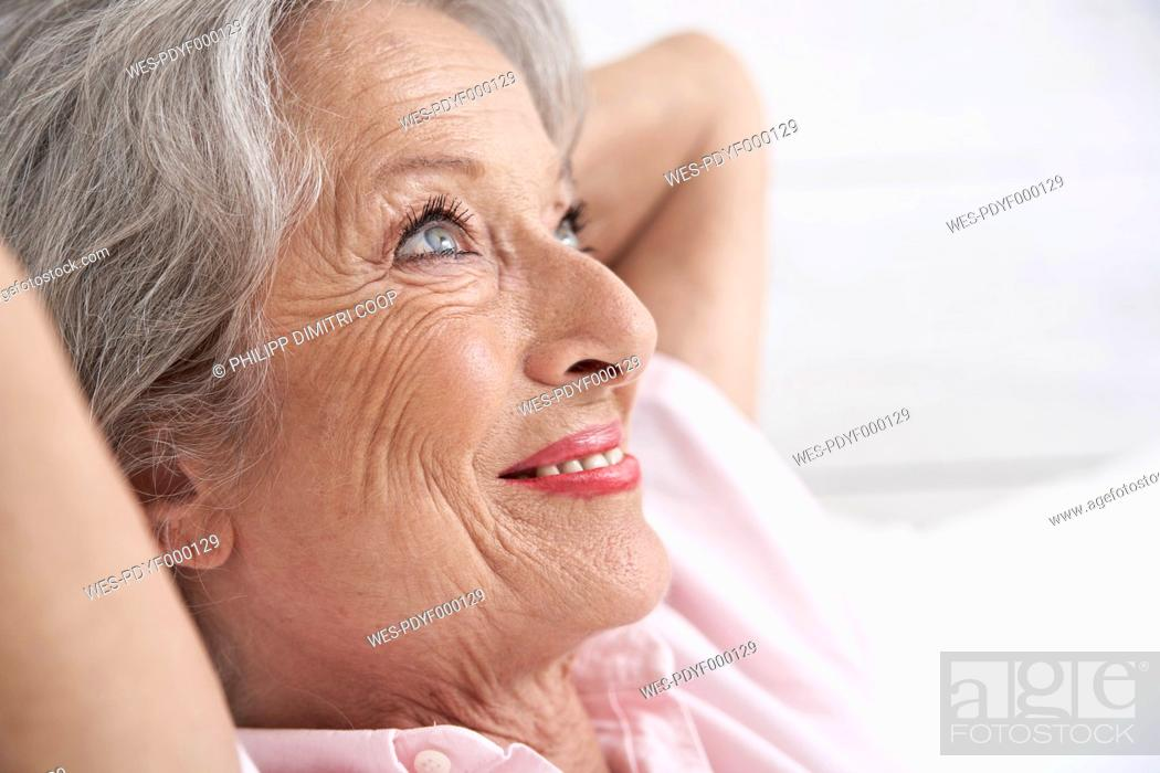 Stock Photo: Spain, Senior woman relaxing, smiling.
