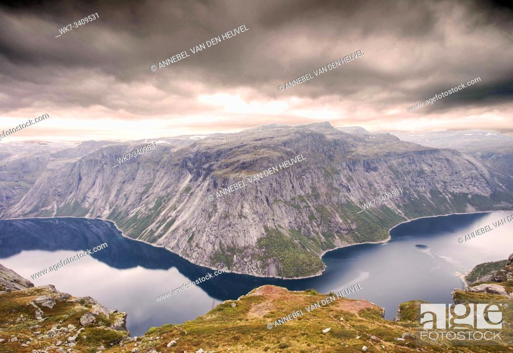 Stock Photo: Rugged dramatic mountain landscape in norway cloudy dramatic day autumn with a calm lake beauty.
