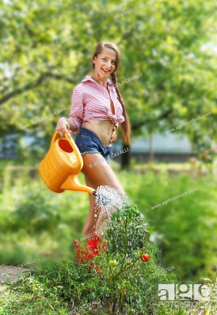 Stock Photo: Sexy woman in the garden. Budapest, Hungary.