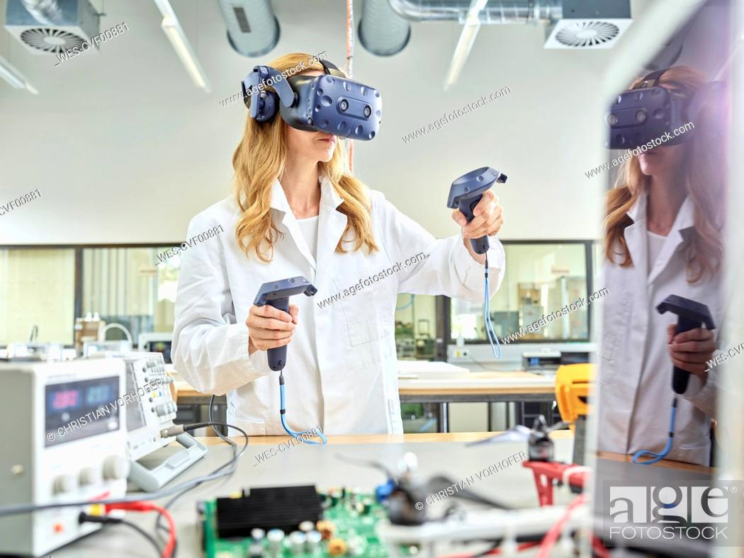 Stock Photo: Female technician working with 3D glasses.