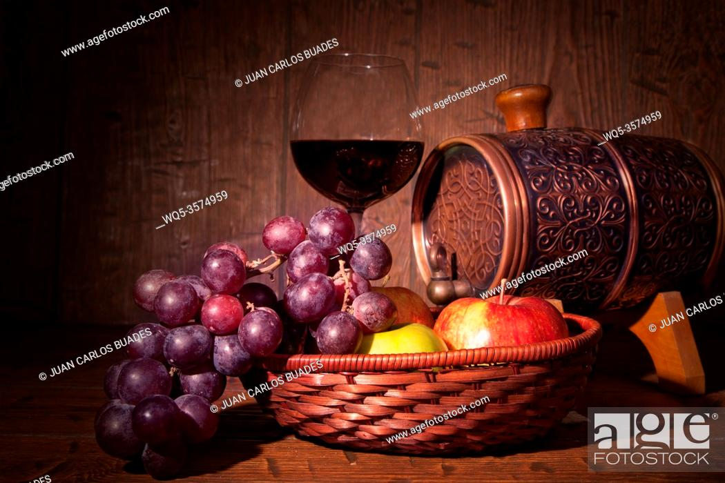 Stock Photo: Glass of red wine and barrel on rustic wood tabel.
