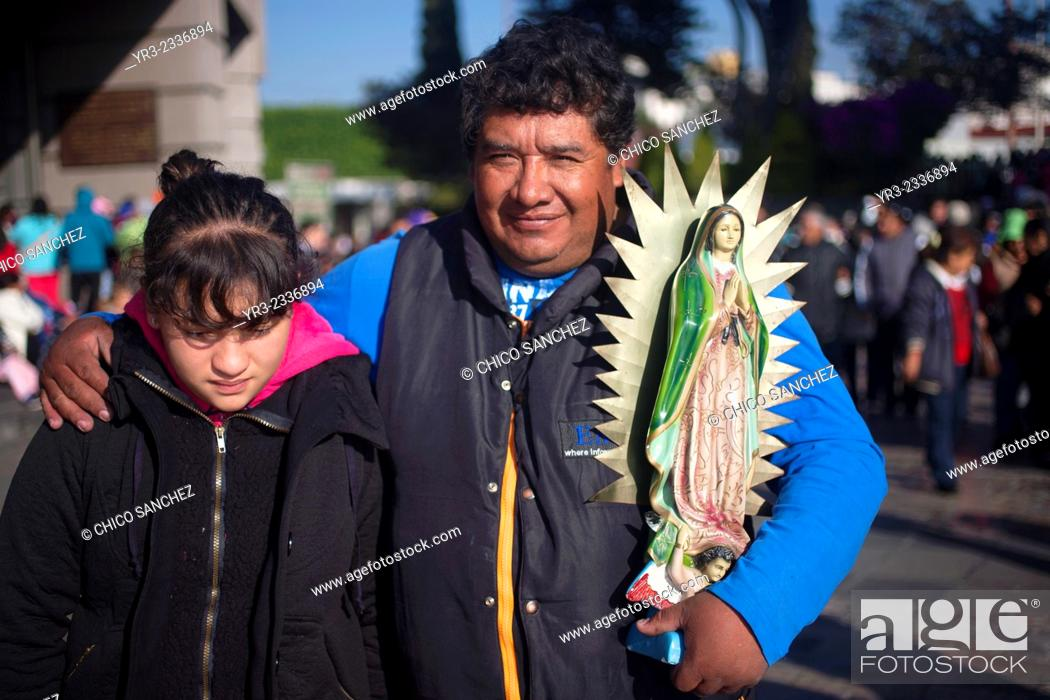 Stock Photo: A pilgrim holds an image of the Virgin of Guadalupe during the annual pilgrimage to the Basilica of Our Lady of Guadalupe, Tepeyac Hill, Mexico City, Mexico.