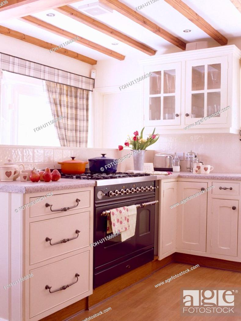 Small White Country Kitchen With Wooden Flooring And Black Oven Stock Photo Picture Rights Managed Image Pic Foh U11566836 Agefotostock