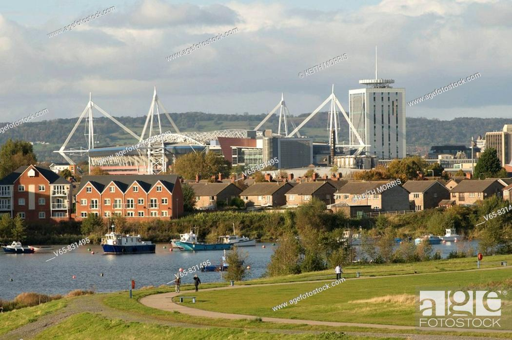 Stock Photo: Cardiff city skyline seen from the bay, with the Millennium Stadium.