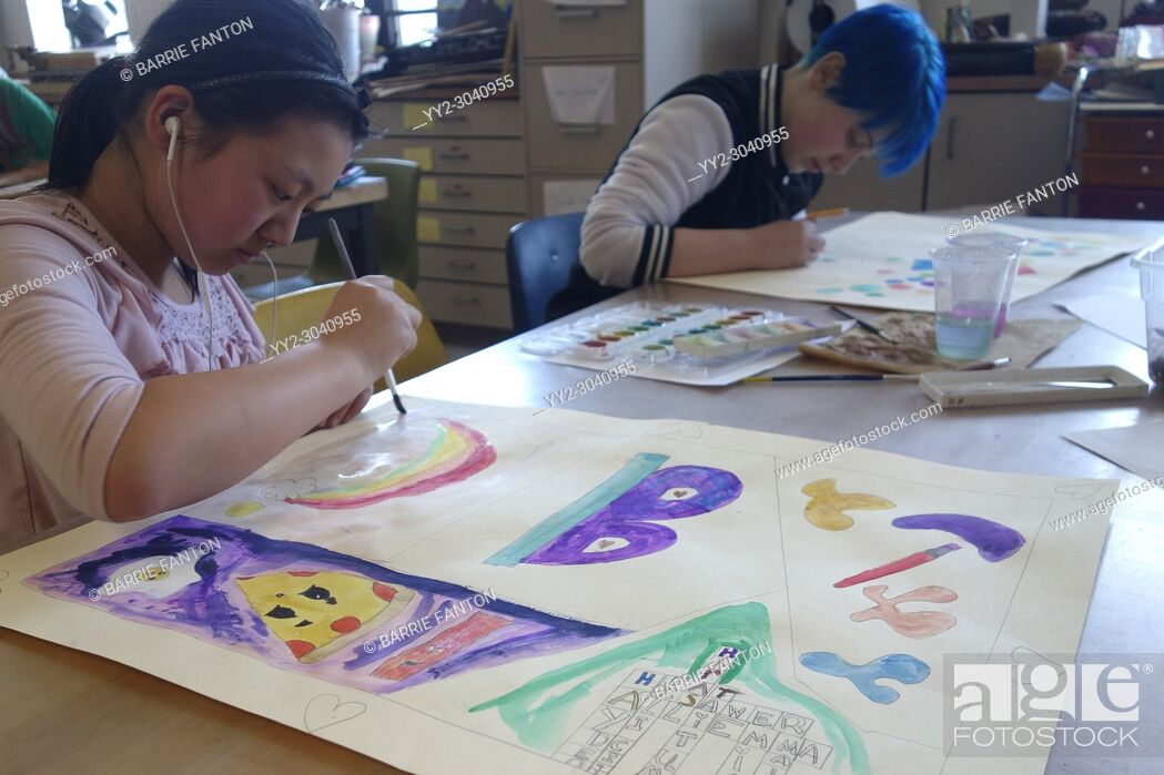 Stock Photo: 6th Grade Girls Painting in Art Class, Wellsville, New York, USA.