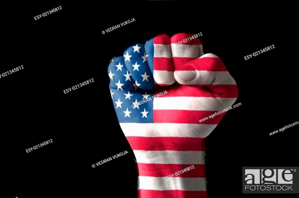 Imagen: Fist painted in colors of usa flag.