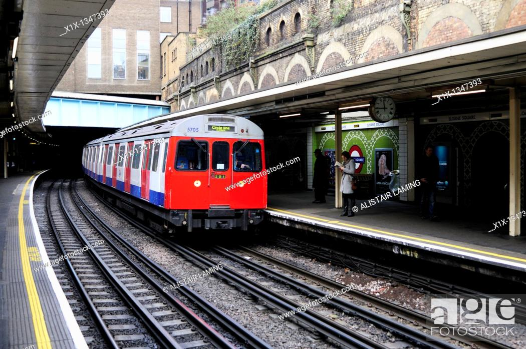 Stock Photo: A Circle Line Train at Sloane Square Underground Tube Station, London, England, Uk.