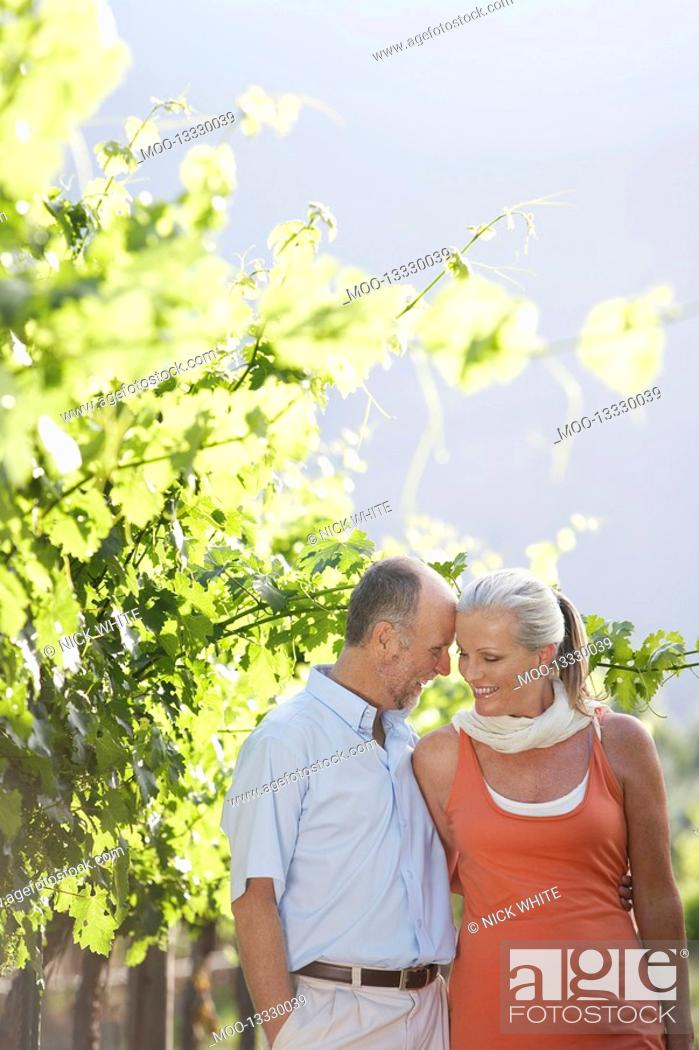 Stock Photo: Portrait of mature couple at the vineyard.