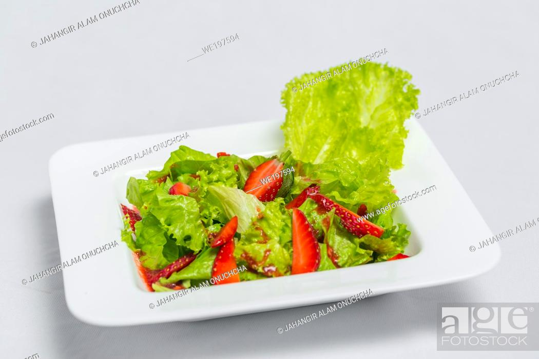 Stock Photo: Colorful delicious Strawberry lettuce Salad with Strawberry Balsamic Dressing. Top View and Closeup views.