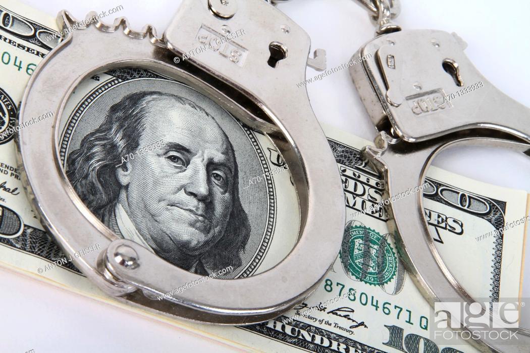 Stock Photo: Symbolic , dollar bank notes and handcuffs.