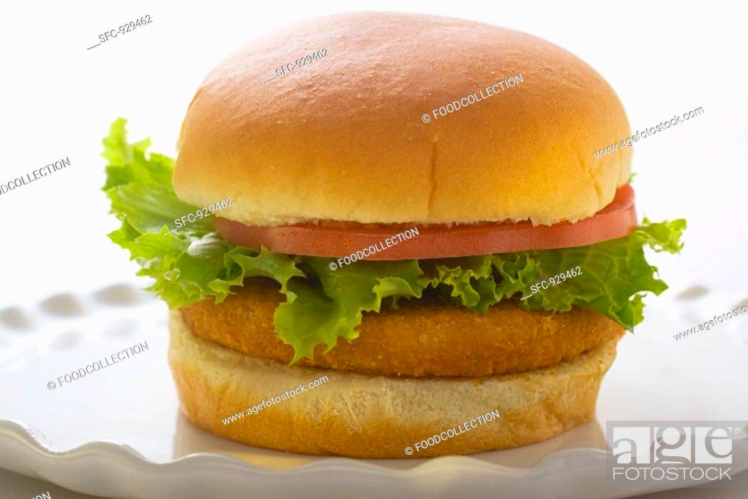Stock Photo: Chicken burger with tomato and lettuce.