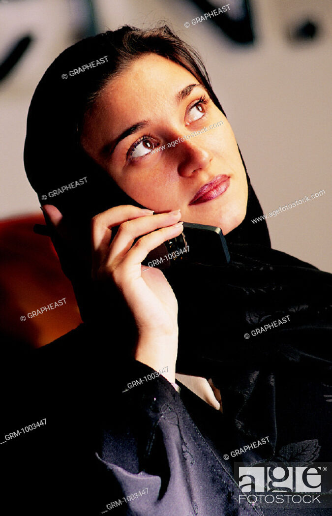 Stock Photo: Arab businesswoman using a mobile phone.