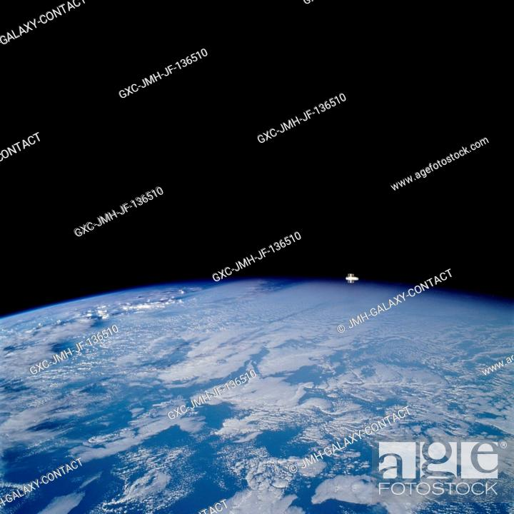 Stock Photo: Looking westward, one of the STS-109 crew members photographed the newly serviced and upgraded Hubble Space Telescope (HST) near the earth's limb to the upper.