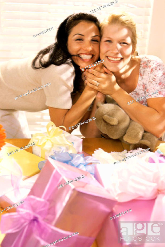 Stock Photo: Portrait of two young women smiling at a baby shower.