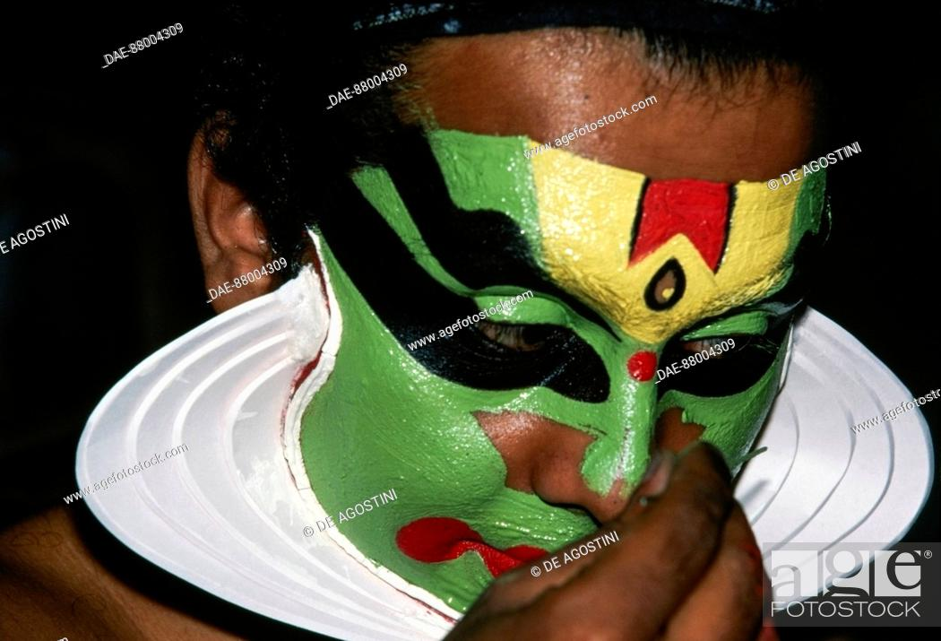 Stock Photo: Actor with face painted during a Kathakali performance, Indian dance-drama, Karthica Thirunal Theatre, Kerala, India.