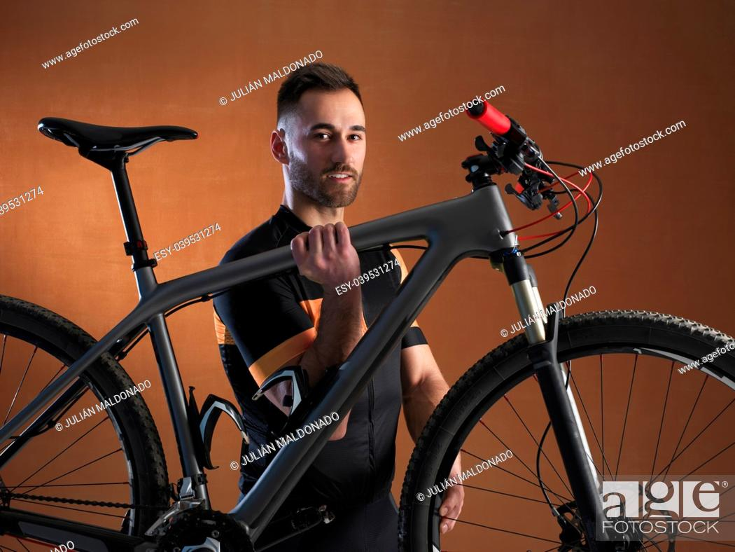 Stock Photo: Cyclist with his equipment and bicycle.