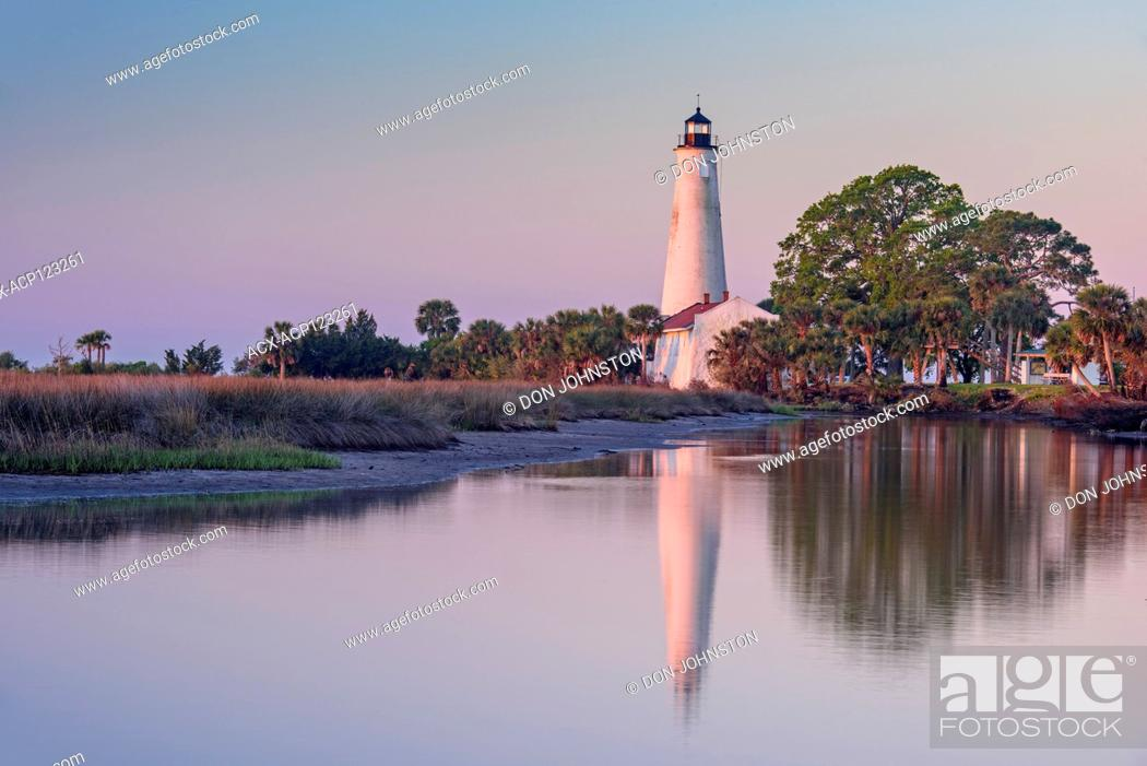 Stock Photo: St. Marks Lighthouse reflected in a slough at dawn, St. Marks NWR, Florida, USA.