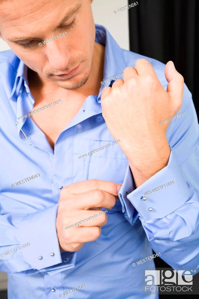 Stock Photo: Man fastening cuff links.