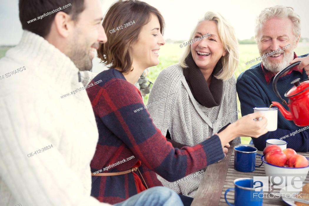 Stock Photo: Couples drinking coffee on patio.