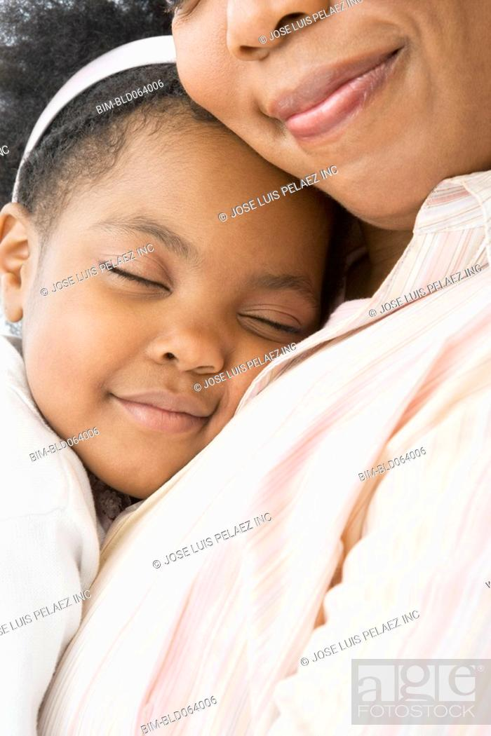 Stock Photo: African mother comforting daughter.