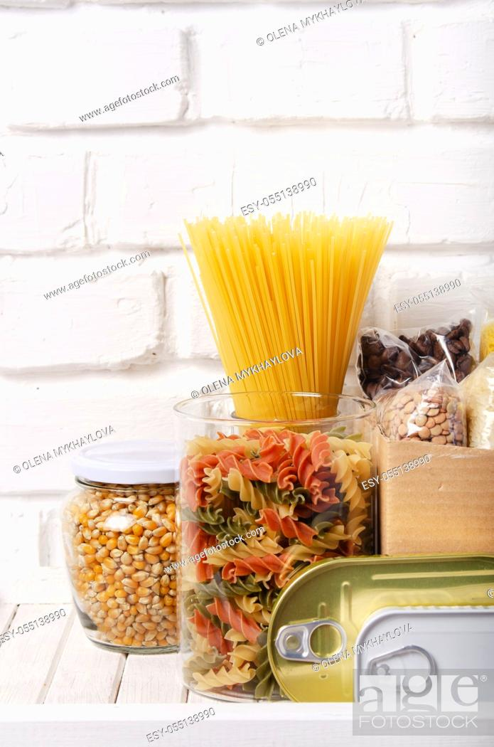 Stock Photo: Set of uncooked foods on pantry shelf prepared for disaster emergency conditions closeup view.