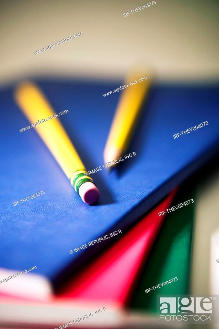 Stock Photo: pencils on the pile of notes.